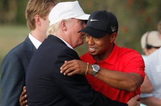 Trump talks with Tiger Woods after he captured the 2013 WGC-Cadillac Championship PGA golf tournament in Doral